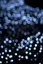Defocused blue light dots against black background Royalty Free Stock Photos