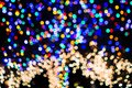 Defocused Christmas lights adorning a tree; Background bokeh of colorful lights; abstract background