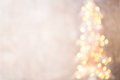 Defocused christmas tree silhouette with blurred lights. Royalty Free Stock Photo