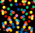 Defocused colored circular lights Royalty Free Stock Photos