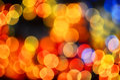 Defocused colourful bokeh okamgnienie zaświeca tło Obrazy Stock