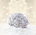 Defocused gold bokeh like champagne splashes christmas backgro card with silver ball and snow on golden background with snowflakes Royalty Free Stock Photos
