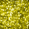 Defocused golden abstract christmas background with bokeh effect of blurred lights Stock Image