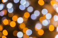 Defocused ligths of Christmas tree. Bokeh Background Royalty Free Stock Photo