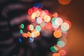 Defocused ligths of christmas tree in the house Stock Photo
