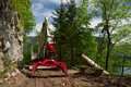 Deforestation knuckleboom log loader used for in clearing Stock Photography