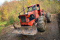 Deforestation tractor in the woods Royalty Free Stock Images