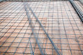 Deformed steel bars frame for beam reinforced steel footing or flooring in construction site. Royalty Free Stock Photo