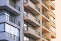 Degrade building balconies of a are lit with fading sunlight Royalty Free Stock Photography