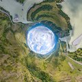 360 degree panoramic of an abstract world turned inside out with green meadows around an oval sky with clouds Royalty Free Stock Photo