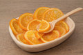 Dehydrated dried orange in wooden bowl Stock Image