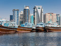 Deira Dhow Wharfage and modern buildings in Dubai Royalty Free Stock Images