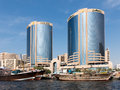 Deira Rolex Twin Towers and dhows, Dubai Creek Royalty Free Stock Photo