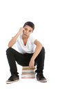 Dejected teenaged boy with his textbooks Royalty Free Stock Photo