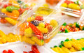 Deletable imitation fruits traditional thai dessert made from nut and jelly in transparent plastic carton Stock Images