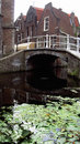 Delft netherlands a bridge on the canal with water lillies underneath Royalty Free Stock Images