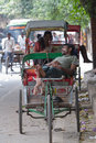 Delhi india august indian trishaw in delhi india bicycle rickshaw on the street of Royalty Free Stock Images