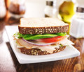 Deli meat sandwich with turkey tomato onion and lettuce shot close up selective focus Stock Photo