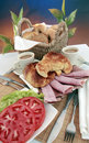 Deli meats croissant and coffee Stock Image
