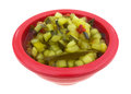 Deli style sweet relish red bowl a side view of a filled with finely chopped Stock Image