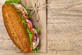 Deli sub sandwich homemade italian with salami tomato and lettuce selective focus Royalty Free Stock Image