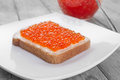 Delicacy breakfast on the wooden table bread with red caviar Stock Photos