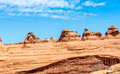 Delicate arch rock formations with Royalty Free Stock Photo