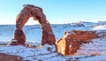 Delicate arch sunrise over after snow Royalty Free Stock Photo