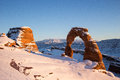 Delicate arch in winter view of covered snow at arches national park Stock Photos