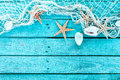Delicate marine border of net, shells and starfish Royalty Free Stock Photo