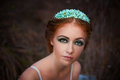 Delicate mysterious bride red haired girl in a white dress in a wreath Royalty Free Stock Photos