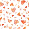 Delicate seamless pattern of stroked hearts and flowers in scribble style. Drawn by multicolor pencil. Isolated on a white backgro