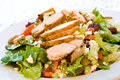 Delicatessen caesar salad with smoked turkey Stock Photo