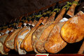 Delicatessen spanish hams dry on the ceiling Royalty Free Stock Images