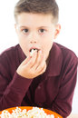 Delicious appetizer photographic portrait of a boy eating some popcorn Royalty Free Stock Image