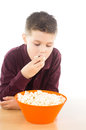 Delicious appetizer photographic portrait of a boy eating some popcorn Royalty Free Stock Photography