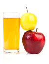 Delicious apple juice in glass and apples isolated on white Stock Photo