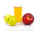 Delicious apple juice in glass and apples on white Stock Photography