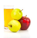 Delicious apple juice in glass and apples on white Royalty Free Stock Photography