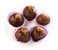 Delicious assorted dark chocolate truffle candies top view on a white plate Royalty Free Stock Image