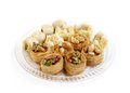 Delicious assorted traditional arabic sweets baklava focus on cashew baklava is a sweet pastry made of layers of phyllo dough Royalty Free Stock Images