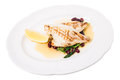 Delicious baked dorado fillet with chard. Royalty Free Stock Photo