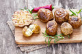 Delicious   baked potato and garlic with chillie and rosemary Royalty Free Stock Photo