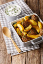 Delicious baked potato with meat balls and herbs in a dish close Royalty Free Stock Photo