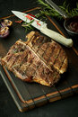 Delicious barbecued t-bone steak with herbs Royalty Free Stock Photo