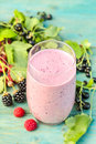 Delicious berry smoothie with raspberries blackberries and blackcurrants Royalty Free Stock Photo