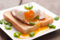 Delicious breakfast. Eggs benedict with ham on toast. Royalty Free Stock Photo