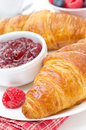Delicious breakfast fresh croissant with raspberry jam close up vertical Stock Photos