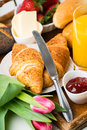 Delicious breakfast with fresh croissants on wooden table Royalty Free Stock Photo