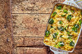 Delicious broccoli casserole with copy space top down view on in rectangular pan over weathered wooden table Stock Photography